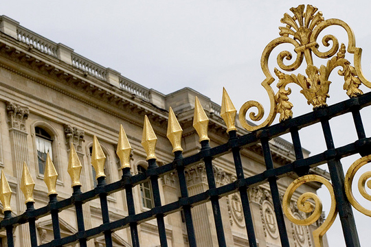 Cast iron and gold railing outside the louvre paris