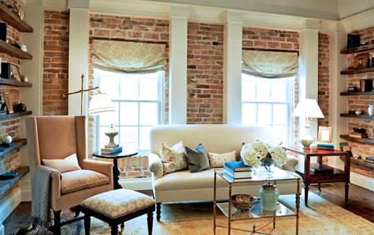 Exposed brick brick wall traditional living room